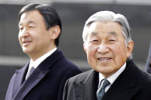 FILE - In this Jan. 26, 2016, file photo, Japan's Emperor Akihito, right, and Crown Prince Naruhito walk at Haneda international airport in Tokyo. Japan's Cabinet has approved for legislative debate a bill to allow 83-year-old Emperor Akihito to abdicate. The legislation endorsed Friday, May 19, 2017 would allow Crown Prince Naruhito to succeed his father as emperor. (AP Photo/Eugene Hoshiko, File)