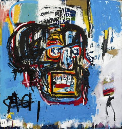 "This undated photo provided by Sotheby's shows Jean-Michel Basquiat's Masterpiece ""Untitled."" Sotheby's said the sale of the artwork Thursday, May 18, 2017, in Manhattan was an auction record for the artist. It also set a record price for an American artist at auction. The 1982 painting depicts a face in the shape of a skull. (Sotheby's via AP)"