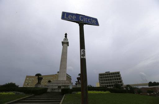 FILE - In this Sept. 2, 2015 file photo, the statue of Gen. Robert E. Lee stands in Lee Circle in New Orleans. The city of New Orleans plans to take down the confederate statue on Friday, May 18, 2017, completing the southern city's removal of four Confederate-related statues that some called divisive. (AP Photo/Gerald Herbert, File)