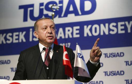 Turkey's President Recep Tayyip Erdogan addresses a business meeting in Istanbul, Thursday, May 18, 2017. Turkey has told the United States it will not join in any military operations that include Kurdish fighters in Syria, Erdogan said Thursday, while vowing to strike the U.S.-backed Kurds if they threaten Turkey's security.(Presidency Press Service, Pool photo via AP)