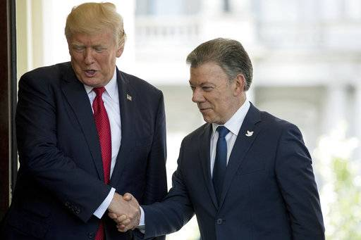 President Donald Trump greets Colombian President Juan Manuel Santos as he arrives at the the White House in Washington, Thursday, May, 18th, 2017. (AP Photo/Andrew Harnik)
