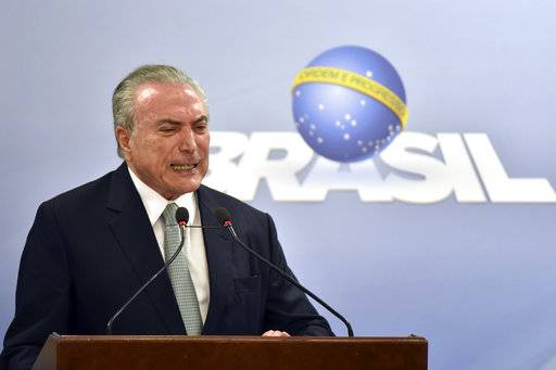 Brazil's President Michel Temer says he will fight allegations that he endorsed the paying of hush money to an ex-lawmaker jailed for corruption, during a national address at the Planalto presidential palace in Brasilia, Brazil, Thursday, May 18, 2017. It was the first appearance since the Globo newspaper published a report Wednesday night that Temer was recorded supporting payments to former Lower House Speaker Eduardo Cunha. (AP Photo/Ricardo Botelho)