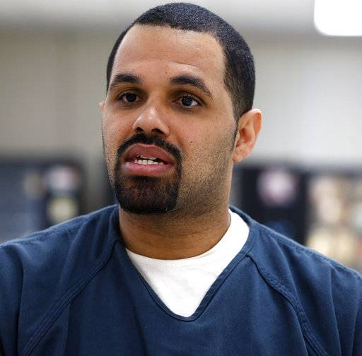 "FILE - In this May 7, 2014 file photo, Rene Lima-Marin sits for an interview with The Associated Press about the circumstances of his sentencing and incarceration, in a meeting room inside Kit Carson Correctional Center, a privately operated prison in Burlington, Colo. Lima-Marin was sent back to prison after being mistakenly released 90 years early. On Tuesday May 16, 2017, a judge ordered him released from prison again, saying it would be ""draconian"" to keep him behind bars and that he has paid his debt to society. (AP Photo/Brennan Linsley, File)"