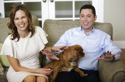 U.S. Rep. Jason Chaffetz and his wife Julie speak with reporters at their home Thursday, May 18, 2017, in Alpine, Utah. Rep. Jason Chaffetz said Thursday that he will resign from Congress next month, a move that calls into question the future of the House Oversight Committee's investigation he promised to lead about President Donald Trump's firing of the FBI director and his presidential campaign's ties with Russia. (AP Photo/Rick Bowmer)