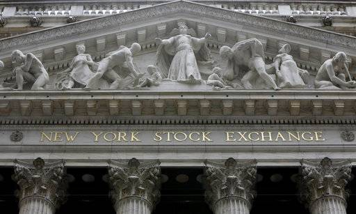 FILE - This Oct. 4, 2014, file photo, shows the facade of the New York Stock Exchange. Stocks are modestly higher in early trading on Wall Street, Thursday, May 18, 2017, as traders were relieved to see some positive results from retailers. (AP Photo/Richard Drew, File)