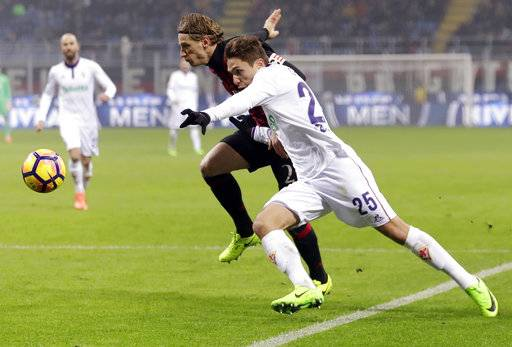 FILE - In this Feb. 19, 2017 file photo, Fiorentina's Federico Chiesa, right, and AC Milan's Ignazio Abate go for the ball during a Serie A soccer match at the San Siro stadium in Milan, Italy. FIFA Under-20 World Cup kicks off in South Korea on Saturday, May 20, 2017. Italy's hopes may rest on the shoulders of Federico Chiesa of Fiorentina who has already established himself in Italy's top tier, Serie A. (AP Photo/Antonio Calanni, File)