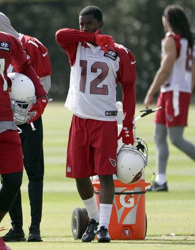 Arizona Cardinals' wide receiver John Brown arrives for a voluntary team NFL football workout, Tuesday, May 16, 2017, in Tempe, Ariz. John ''Smokey'' Brown went through a difficult 2016 season, fighting fatigue and weakness as doctors tried to figure out just what was wrong. Eventually, they seem to have found out, and the diminutive speedster is ready to resume his role as a critical part of the Arizona Cardinals' offense. (AP Photo/Matt York)