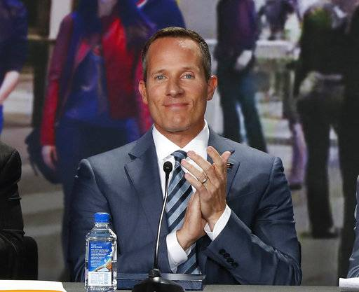 FILE - In this Nov. 22, 2016, file photo, Chris Ilitch smiles during a press conference in Detroit. Chris Ilitch has been unanimously approved as the new controlling owner of the Detroit Tigers. Baseball Commissioner Rob Manfred made the announcement Thursday, May 18, 2017, following the vote during a quarterly owners' meeting. Tigers owner Mike Ilitch died in February at age 87. (AP Photo/Paul Sancya, File)
