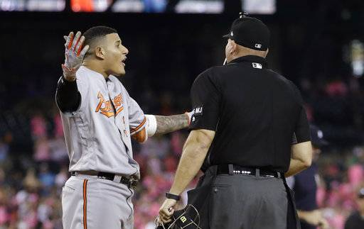 Baltimore Orioles' Manny Machado argues a strike call with home plate umpire Mark Carlson that ended the team's baseball game against the Detroit Tigers, Wednesday, May 17, 2017, in Detroit. Detroit won 5-4. (AP Photo/Carlos Osorio)