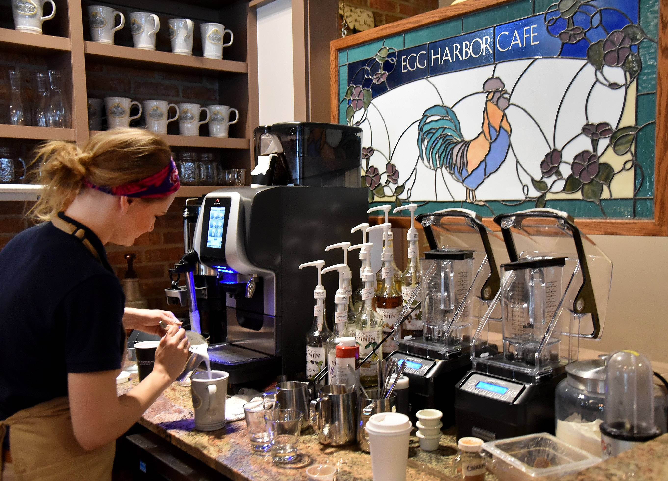 Riley Wade makes a latte at Egg Harbor Cafe's new barista bar in Arlington Heights. The bar serves coffee drinks, smoothies and other drinks to-go.