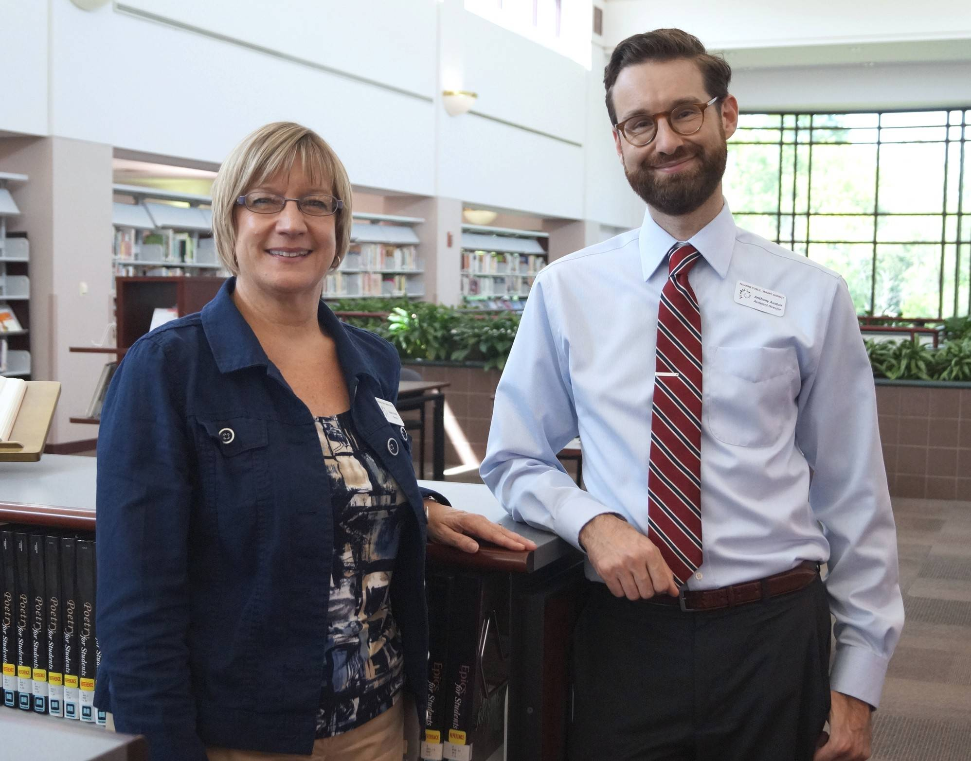 Anthony Auston, right, replaced Susan Strunk as Palatine Public Library District director in August 2014. He's leaving Palatine to become executive deputy director of Mount Prospect Public Library.