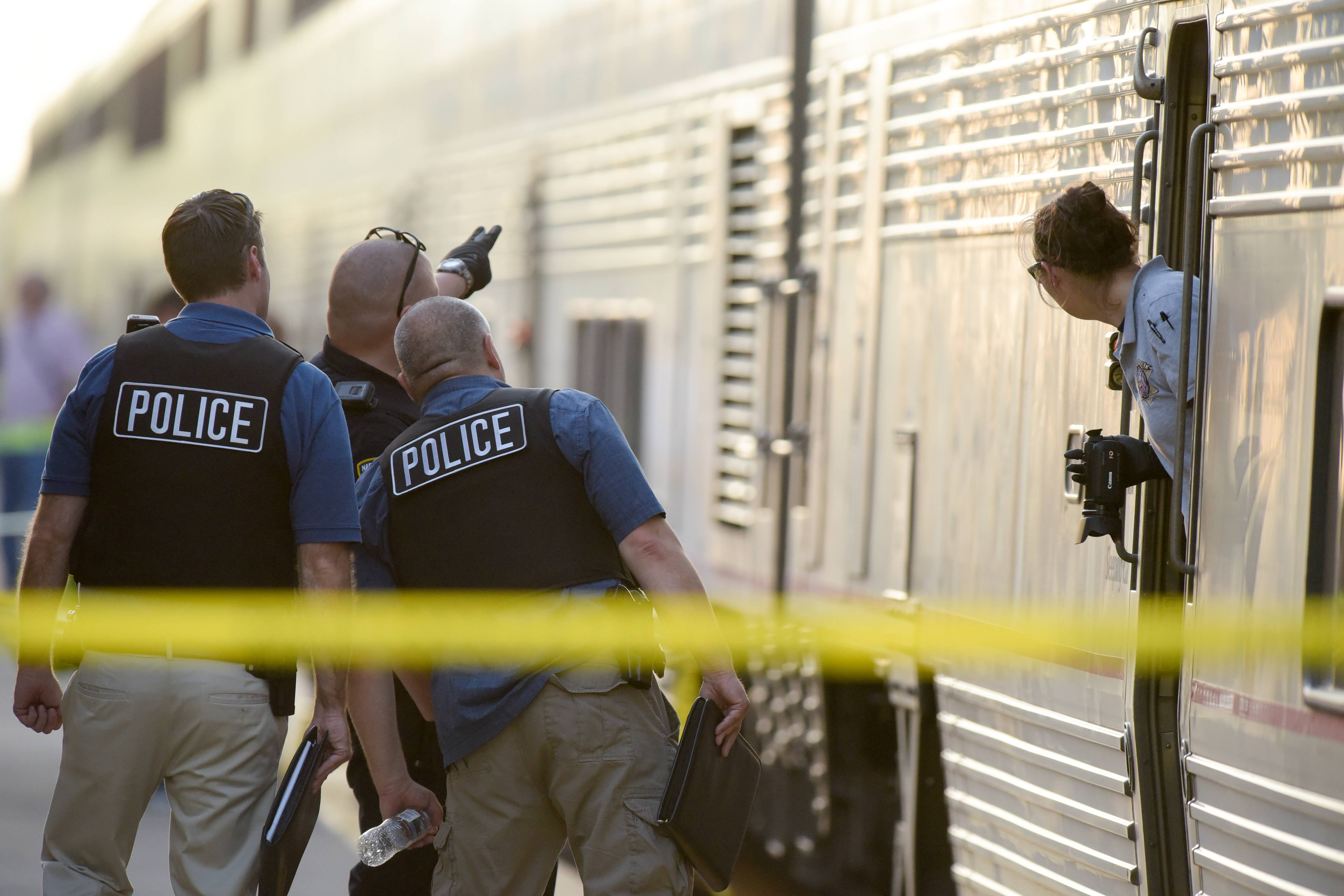 Police investigate the shooting of an Amtrak conductor at the Naperville train station on May 16. Edward Klein, 79, of West Allis, Wisconsin, is being held on $1.5 million bail after being charged with attempted murder and aggravated battery in the shooting.