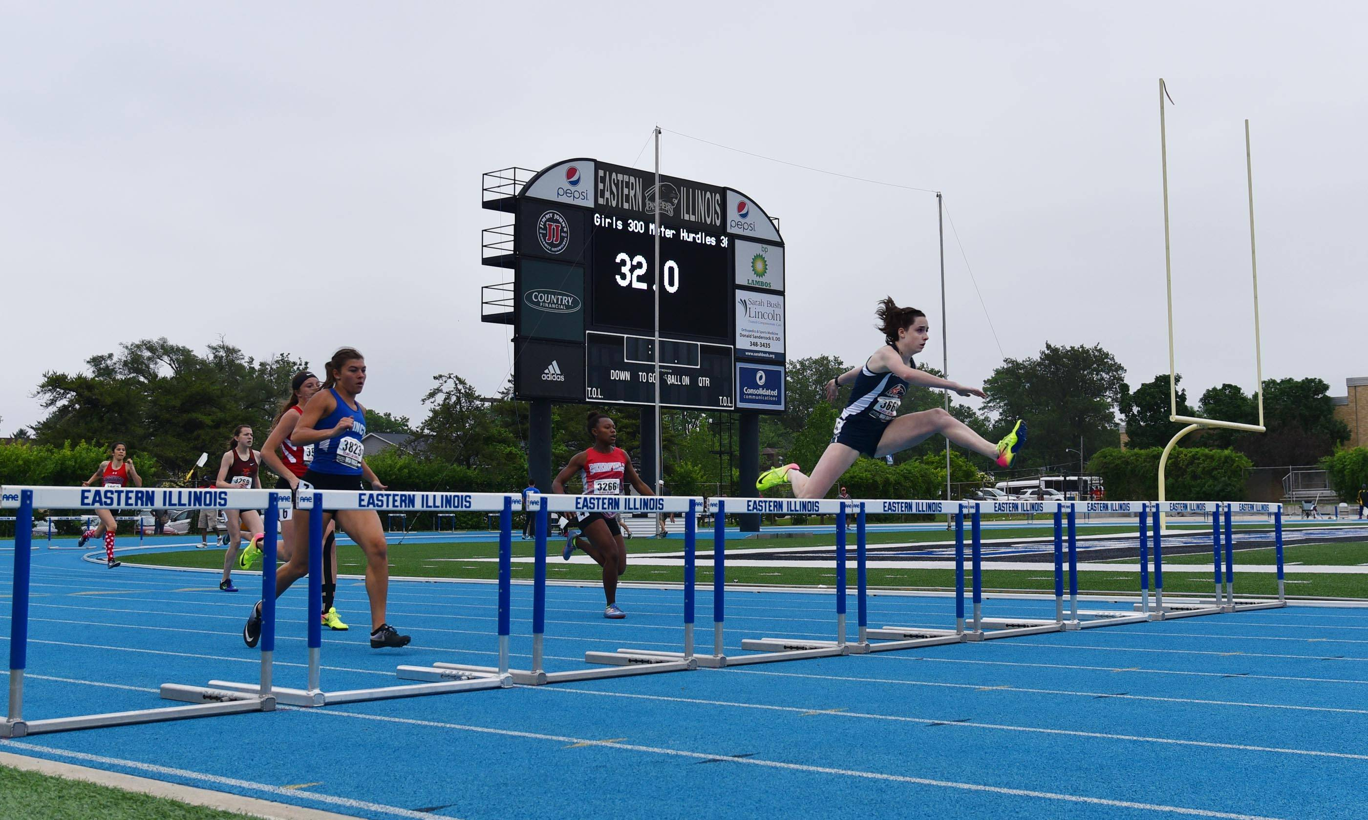 Naperville North's Halle Bieber leads the Class 3A 300-Meter Hurdles at the prelims of the state girls track and field meet Friday at Eastern Illinois University in Charleston.