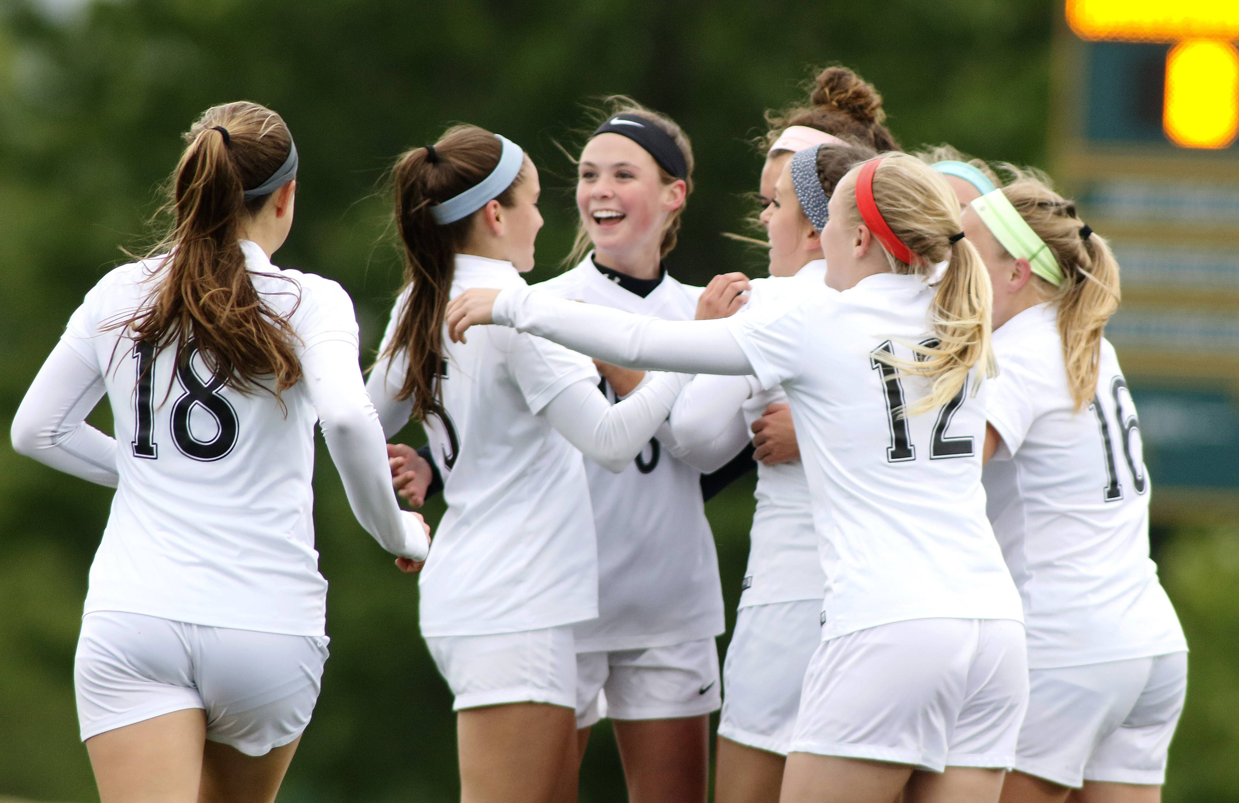 Metea Valley girls celebrate their first and only goal of a 1-0 win over Waubonsie Valley during regional girls soccer action in Aurora.