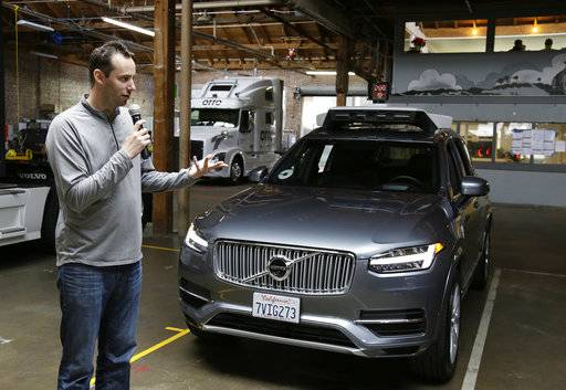 FILE - In this Dec. 13, 2016, file photo, Anthony Levandowski, head of Uber's self-driving program, speaks about their driverless car in San Francisco. Uber is threatening to fireLevandowski, accused of stealing self-driving car technology from a Google spin-off unless he waives his constitutional right against self-incrimination so the ride-hailing service can comply with a court order. Waymo, a self-driving car company started by Google, alleges Levandowski downloaded 14,000 documents containing its trade secrets before he founded his startup. (AP Photo/Eric Risberg, File)