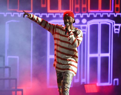 "FILE - In this May 7, 2017, file photo, Big Sean performs ""Jump Out the Window"" at the MTV Movie and TV Awards at the Shrine Auditorium in Los Angeles. It was announced on May 19, 2017, that Big Sean will headline Billboard's Hot 100 Music Festival on New York's Jones Beach. The two-day concert begins Aug. 19. (Photo by Chris Pizzello/Invision/AP, File)"
