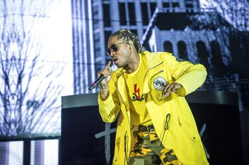 FILE - In this Saturday, May 6, 2017 file photo, Future performs at the Bold Sphere Music at Champions Square in New Orleans. Police say people leaving a concert by the rapper Future in Brooklyn reported hearing gunshots, but officers found no evidence of actual gunfire when they arrived. Some concertgoers reported on social media that some people started running and ducking for cover Friday night, May 19, 2017, after hearing the sound at the Barclays Center. (Photo by Amy Harris/Invision/AP, File)