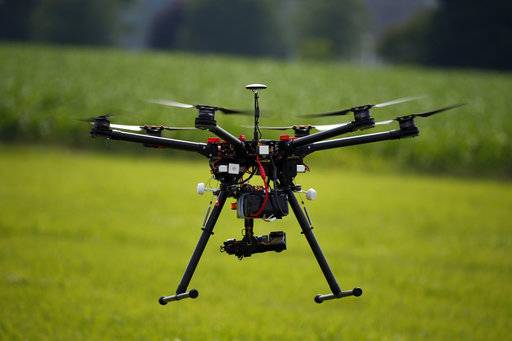 FILE - In this June 11, 2015, file photo, a hexacopter drone is flown during a drone demonstration in Cordova, Md. An appeals court has struck down a Federal Aviation Administration rule that required owners to register drones used for recreation.