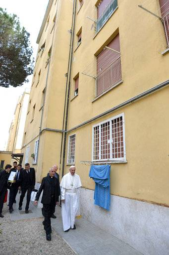 Pope Francis visits a popular neighborhood in Ostia, near Roma, where he made a surprise visit along with local priest, stopping in various homes to bless the families living there, Friday, May 19, 2017. (L'Osservatore Romano/Pool via AP)