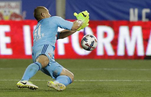 New York Red Bulls goalkeeper Luis Robles stops a penalty shot by Toronto FC forward Jozy Altidore during the second half of an MLS soccer match, Friday, May 19, 2017, in Harrison, N.J. The teams tied 1-1.