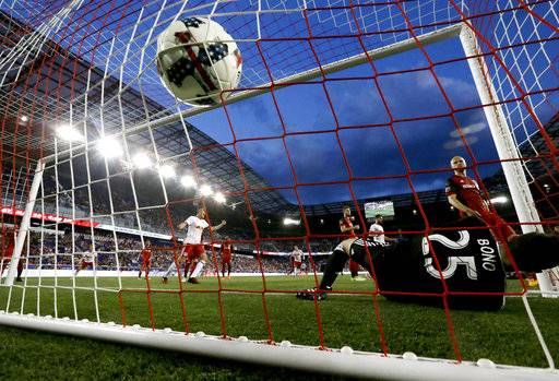 The ball hits the back of the net as Toronto FC goalkeeper Alex Bono (25) is unable to stop a shot by New York Red Bulls forward Bradley Wright-Phillips (99) during the first half of an MLS soccer match, Friday, May 19, 2017, in Harrison, N.J.