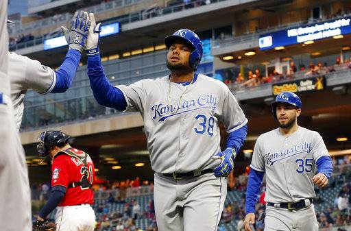 Kansas City Royals' Jorge Bonifacio, left, gets congratulations as he and Eric Hosmer, right, score on Bonifacio's two-run home run off Minnesota Twins pitcher Hector Santiago during the third inning of a baseball game Friday, May 19, 2017, in Minneapolis.