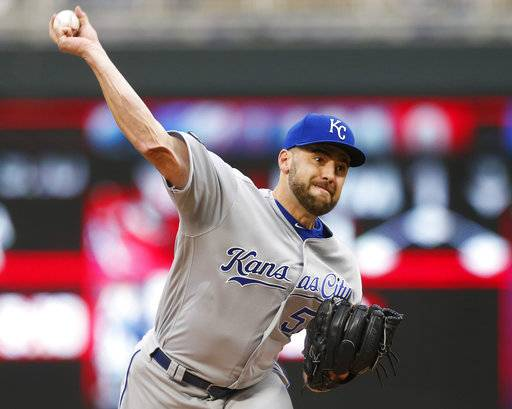Kansas City Royals pitcher Nathan Karns throws against the Minnesota Twins during the first inning of a baseball game Friday, May 19, 2017, in Minneapolis.