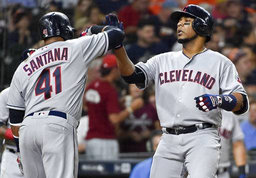Cleveland Indians designated hitter Edwin Encarnacion celebrates his two-run home run off Houston Astros starting pitcher Charlie Morton with teammate Carlos Santana (41) during the fourth inning of a baseball game, Friday, May 19, 2017, in Houston.