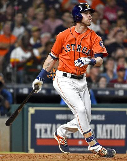 Houston Astros' Josh Reddick watches his solo home run off Cleveland Indians starting pitcher Trevor Bauer during the third inning of a baseball game, Friday, May 19, 2017, in Houston.
