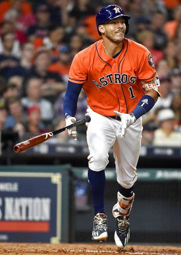 Houston Astros' Carlos Correa watches his solo home run off Cleveland Indians starting pitcher Trevor Bauer sixth inning of a baseball game, Friday, May 19, 2017, in Houston.