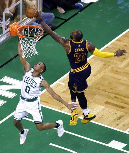 Cleveland Cavaliers forward LeBron James, right, blocks a shot by Boston Celtics guard Avery Bradley during the first half of Game 2 of the NBA basketball Eastern Conference finals, Friday, May 19, 2017, in Boston.