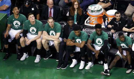 Players on the Boston Celtics bench watch play during the second half of Game 2 of the NBA basketball Eastern Conference finals against the Cleveland Cavaliers, Friday, May 19, 2017, in Boston.