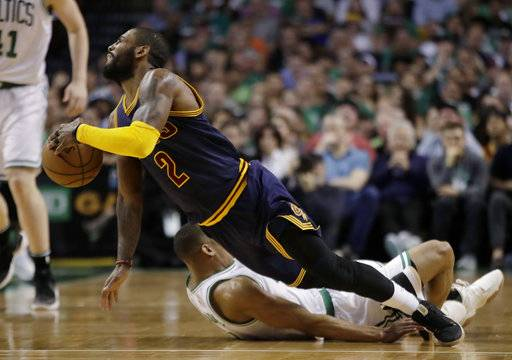Cleveland Cavaliers guard Kyrie Irving (2) falls with Boston Celtics guard Avery Bradley (0) during the first half of Game 2 of the NBA basketball Eastern Conference finals, Friday, May 19, 2017, in Boston.