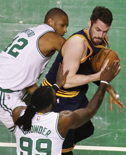 Boston Celtics center Al Horford, left, and forward Jae Crowder (99) defend against Cleveland Cavaliers forward Kevin Love, right, during first half of Game 2 of the NBA basketball Eastern Conference finals, Friday, May 19, 2017, in Boston.