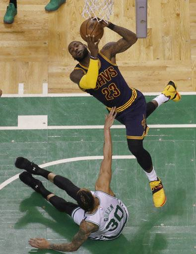 Cleveland Cavaliers forward LeBron James (23) shoots over Boston Celtics forward Gerald Green (30) during first half of Game 2 of the NBA basketball Eastern Conference finals, Friday, May 19, 2017, in Boston.