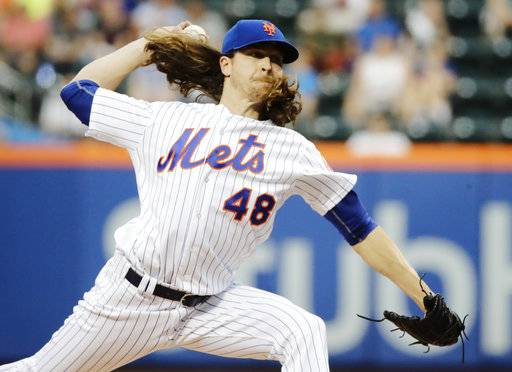 New York Mets' Jacob deGrom (48) delivers a pitch during the first inning of a baseball game against the Los Angeles Angels, Friday, May 19, 2017, in New York. (AP Photo/Frank Franklin II)