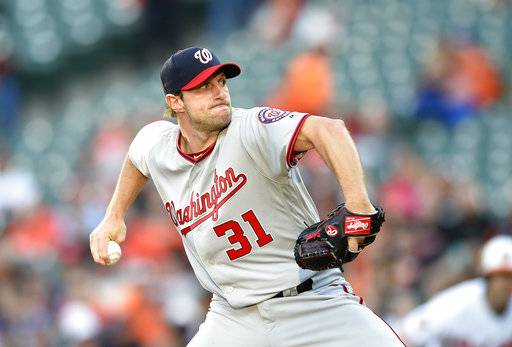 FILE - In this May 9, 2017, file photo, Washington Nationals starting pitcher Max Scherzer (31) delivers during an interleague baseball game against the Baltimore Orioles in Baltimore. Scherzer says he is ready to start against Atlanta on Saturday, May 20, 2017, six days after he was struck on the left knee by a line drive off the bat of Philadelphia's Michael Saunders. (AP Photo/Nick Wass. File)
