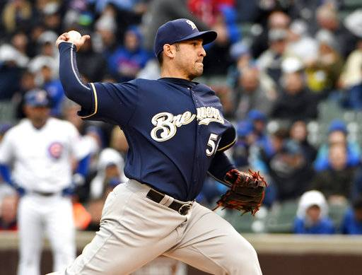 Milwaukee Brewers stating pitcher (56) Paolo Espino throws against the Chicago Cubs during the first inning of a baseball game, Friday, May, 19, 2017, in Chicago. (AP Photo/David Banks)