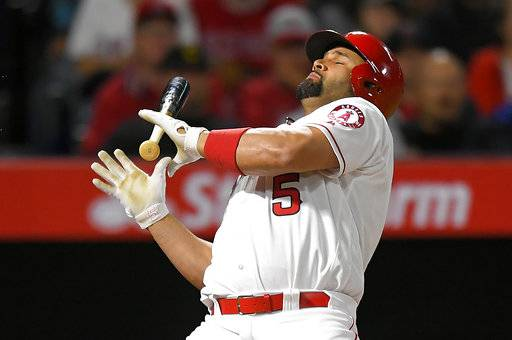 Los Angeles Angels' Albert Pujols backs out of the way of a close pitch during the fifth inning of the team's baseball game against the Chicago White Sox, Wednesday, May 17, 2017, in Anaheim, Calif. (AP Photo/Mark J. Terrill)