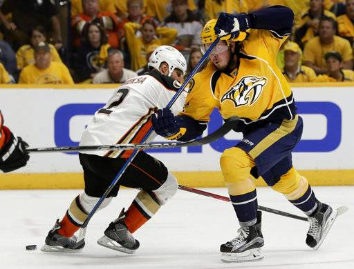 Anaheim Ducks defenseman Kevin Bieksa (2) battles against Nashville Predators center Ryan Johansen (92) in the second period of Game 4 of the Western Conference final in the NHL hockey Stanley Cup playoffs Thursday, May 18, 2017, in Nashville, Tenn.