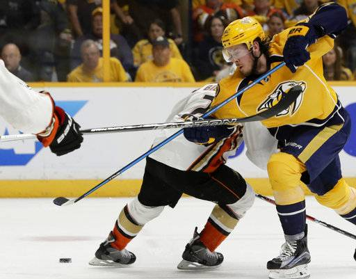 Anaheim Ducks defenseman Kevin Bieksa (2) battles against Nashville Predators center Ryan Johansen,foreground, in the second period of Game 4 of the Western Conference final in the NHL hockey Stanley Cup playoffs Thursday, May 18, 2017, in Nashville, Tenn.