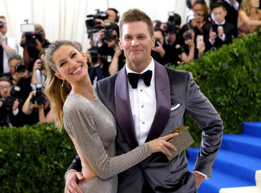 "FILE - In this May 1, 2017, file photo, Gisele Bundchen, left, and Tom Brady attend The Metropolitan Museum of Art's Costume Institute benefit gala celebrating the opening of the Rei Kawakubo/Comme des Garçons: Art of the In-Between exhibition in New York. Bundchen told ""CBS This Morning"" in an interview that aired May 17, 2017, that Brady suffered a concussion last year. (Photo by Charles Sykes/Invision/AP, File)"