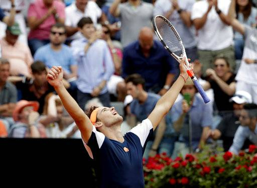 Dominic Thiem of Austria celebrates after beating Rafael Nadal of Spain at the Italian Open tennis tournament, in Rome, Friday, May 19, 2017.