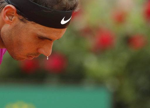 Rafael Nadal of Spain sweats during his match against Dominic Thiem of Austria at the Italian Open tennis tournament, in Rome, Friday, May 19, 2017. Thiem beat Nadal 6-4, 6-3.