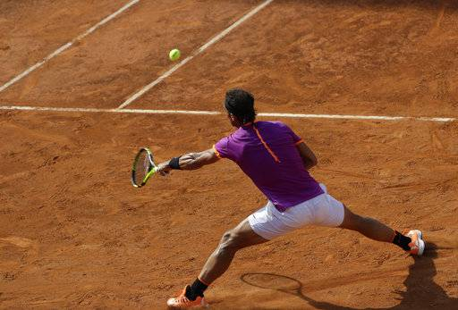 Rafael Nadal of Spain returns a ball during his match against Dominic Thiem of Austria at the Italian Open tennis tournament, in Rome, Friday, May 19, 2017. Thiem beat Nadal 6-4, 6-3.