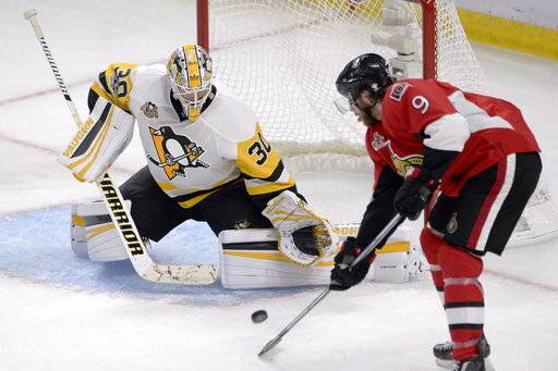 Ottawa Senators right wing Bobby Ryan (9) deflects a shot on net as Pittsburgh Penguins goalie Matt Murray (30) makes a save during the second period of game three of the Eastern Conference final in the NHL Stanley Cup hockey playoffs in Ottawa on Wednesday, May 17, 2017. (Adrian Wyld/The Canadian Press via AP)