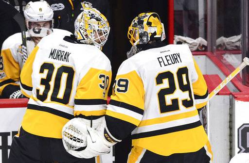 Pittsburgh Penguins goalie Marc-Andre Fleury (29) chats with goalie Matt Murray (30) after being pulled during the first period of game three of the Eastern Conference final in the NHL Stanley Cup hockey playoffs against the Ottawa Senators in Ottawa on Wednesday, May 17, 2017. (Sean Kilpatrick/The Canadian Press via AP)