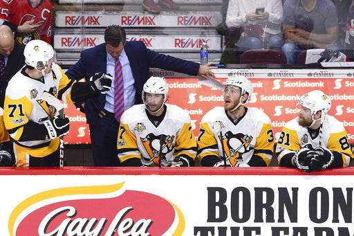 Pittsburgh Penguins head coach Mike Sullivan, center Evgeni Malkin (71) centre Matt Cullen (7) right wing Carter Rowney (37) and right wing Phil Kessel (81) look on during a stoppage in play first period of game three of the Eastern Conference final in the NHL Stanley Cup hockey playoffs against the Ottawa Senators in Ottawa on Wednesday, May 17, 2017. (Sean Kilpatrick/The Canadian Press via AP)