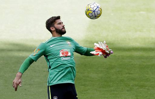 FILE - In this Nov. 8, 2016, file photo, Brazil goalkeeper Alisson attends a training session in Belo Horizonte, Brazil. Brazil has been so dominant that it qualified for next year's World Cup in Russia with more than a year to go. But there's a problem. Despite Brazil's overwhelming talent, it lacks a world-class goalkeeper. The candidates are either struggling to play top-level football in Europe, or have little international experience. (AP Photo/Andre Penner, File)