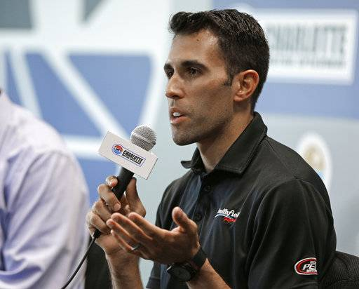Aric Almirola speaks to the media during a news conference before practice for Saturday's NASCAR Cup series All-Star auto race at Charlotte Motor Speedway in Concord, N.C., Friday, May 19, 2017. Almirola was injured in a crash during a race last week and will be out for 8-12 weeks. (AP Photo/Chuck Burton)